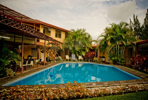 Puerta del sol hotel in ciudad cariari residencial los for Parking puerta del sol